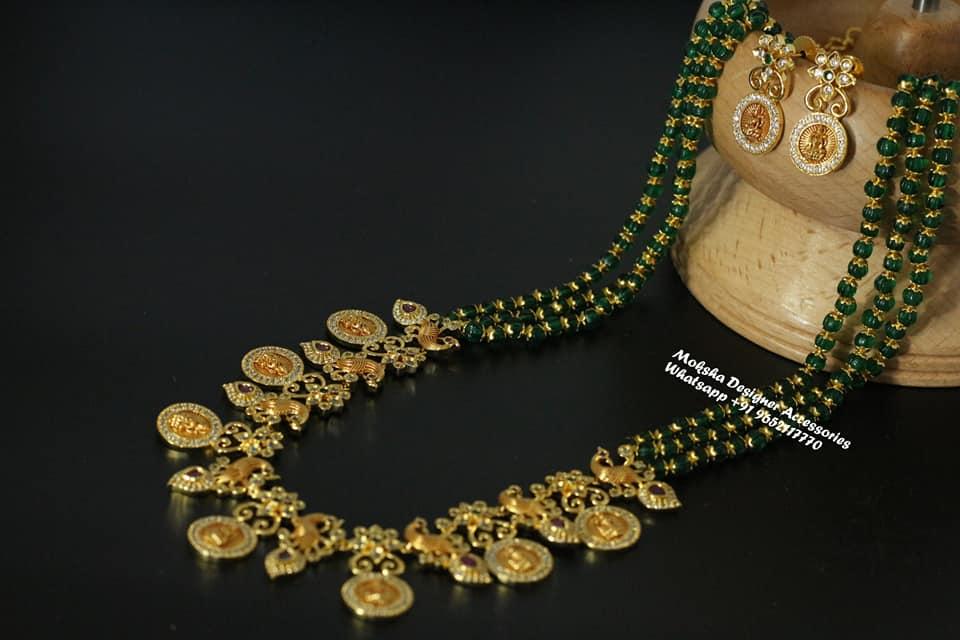 Beautiful one gram gold green bead Lakshmi kasu long haaram. 1 gram gold haram with price 1 gram jewellery online one gram gold jewellery long chains