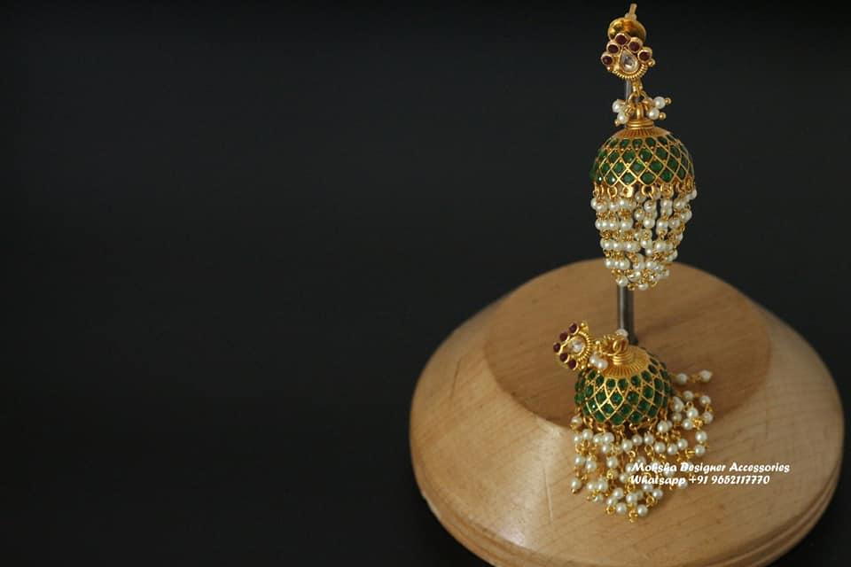 Beautiful one gram gold jumkhis with guttapusalu hangings.
