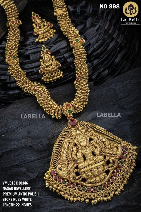 Beautiful one gram gold long haaram with nakshi work Lakshmi pendant and earrings. one gram gold ornaments with price one gram gold wedding jewellery sets 1 gram gold haram designs