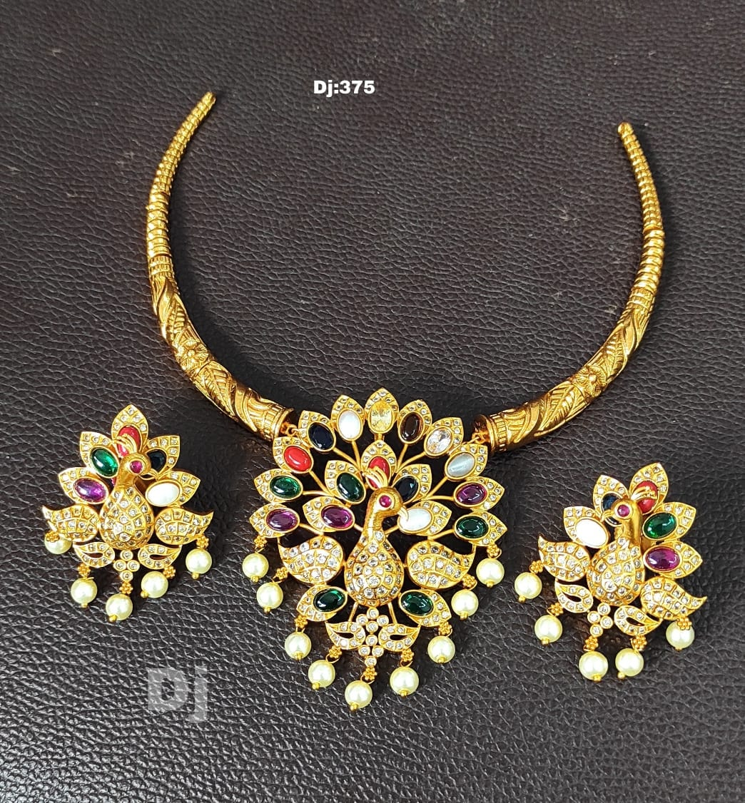 Beautiful one gram gold kanthi necklace with peacock pendnat. l gram gold jewellery online one gram gold black dori necklace one gram necklaces with price