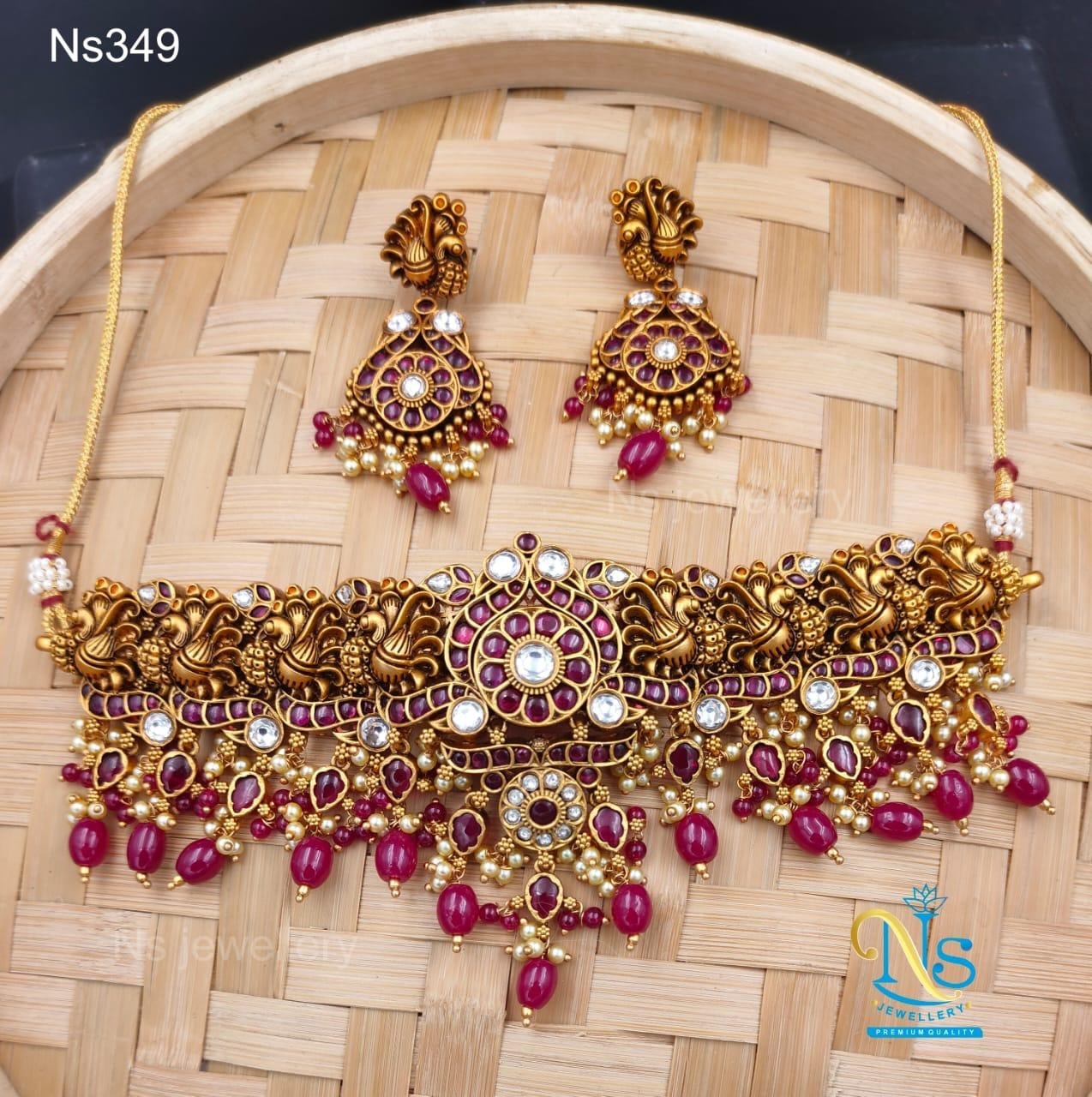 Beautiful one gram gold swan motif necklace with matching earrings.