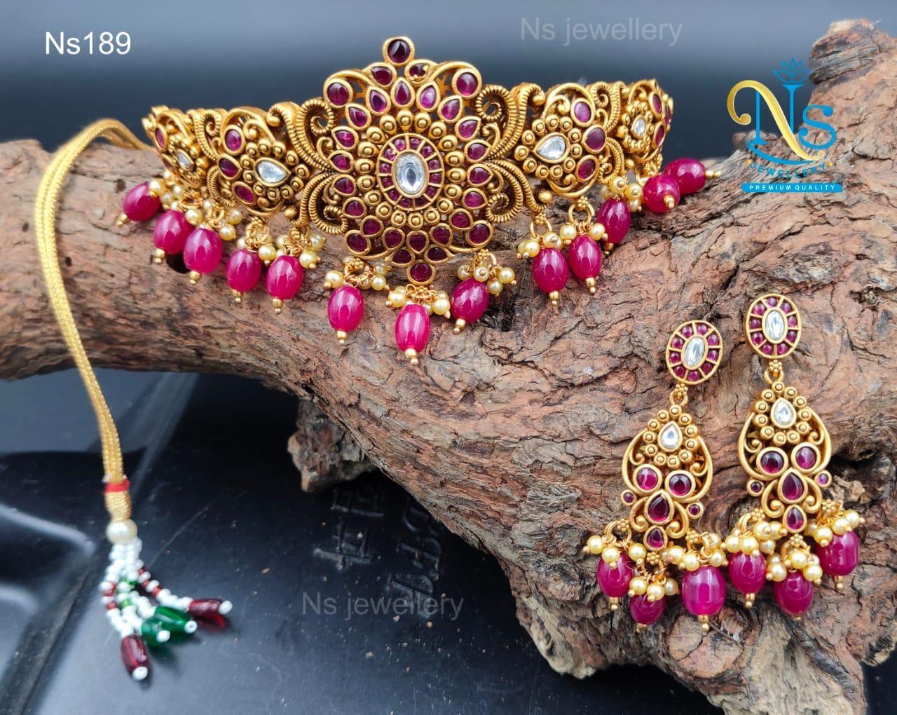 Beautiful one gram gold choker with matching earrings.