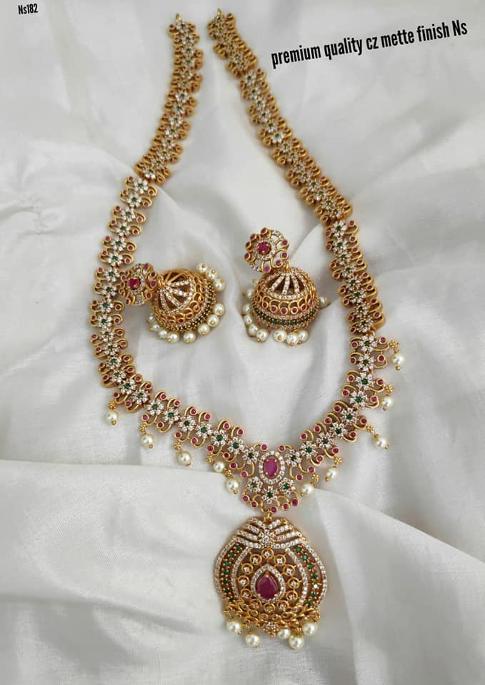Gorgeous one gram gold long haaram studded with multi color CZS. Long haram with matching jumkhis. griham one gram gold jewellery 1 gram gold anklets 1 gram jewellery online shopping