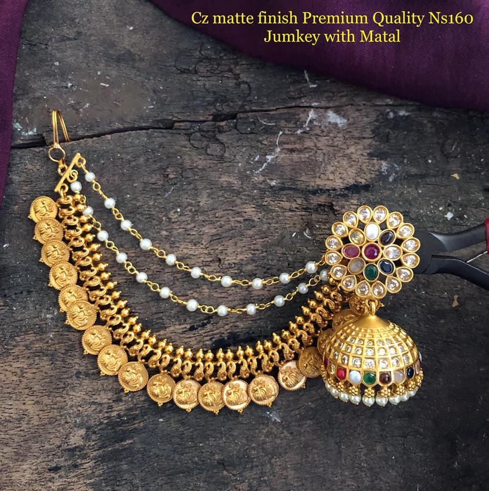 Beautiful one gram gold  jumkhis studded with navaraatan stones and Lakshmi kasu champasralu.