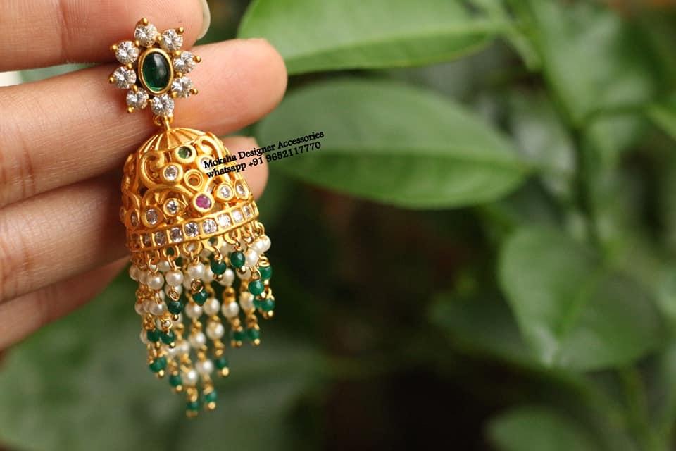 Beautiful one gram gold jumkhis with bead string hangings.