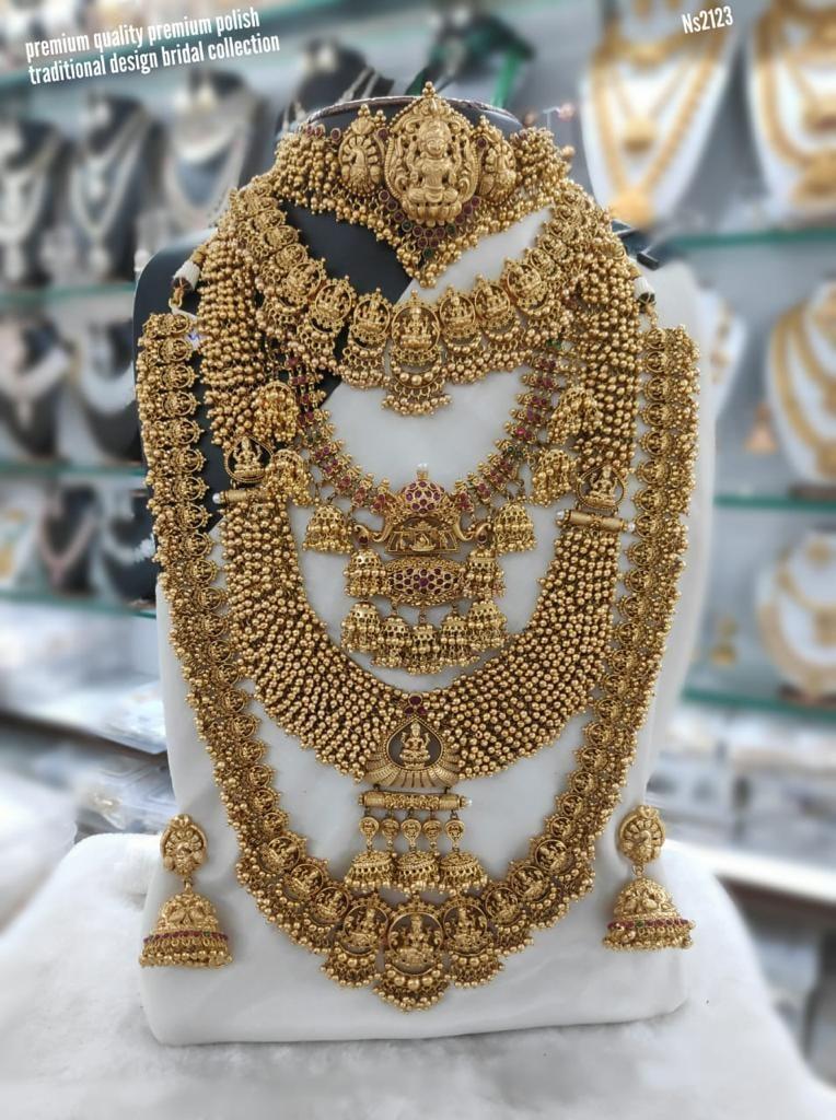 Beautiful one gram gold bridal set with Lakshmi devi motifs.