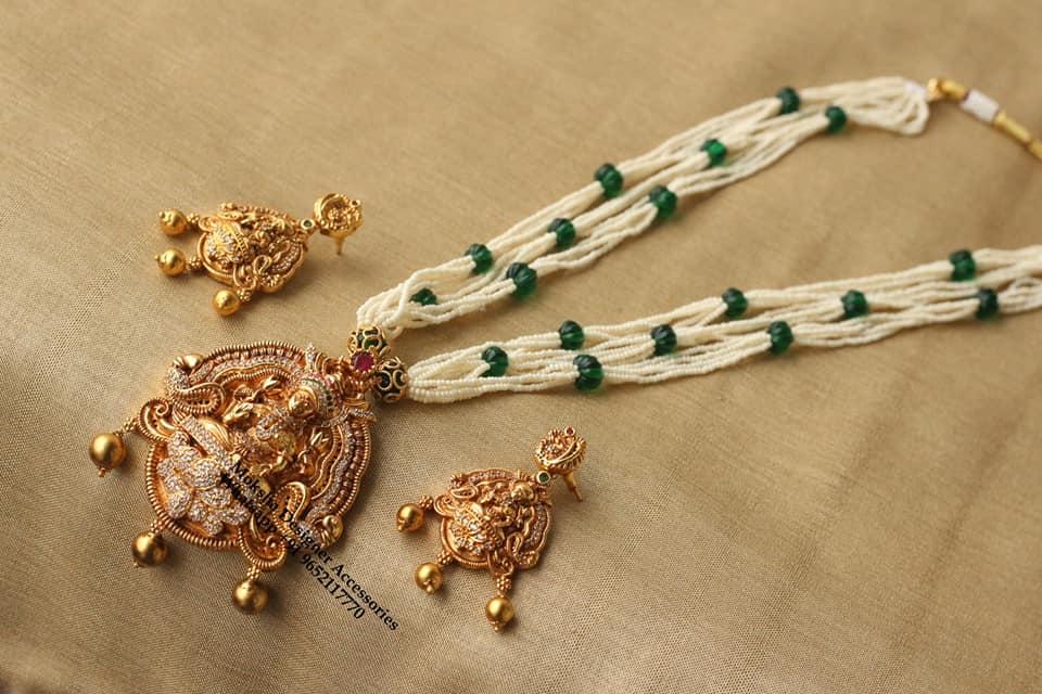 Beautiful one gram gold bead long haaram with Lakshmi devi pendant and matching earrings. 1 gram gold chain price one gram gold ornaments 1gm gold jewellery online