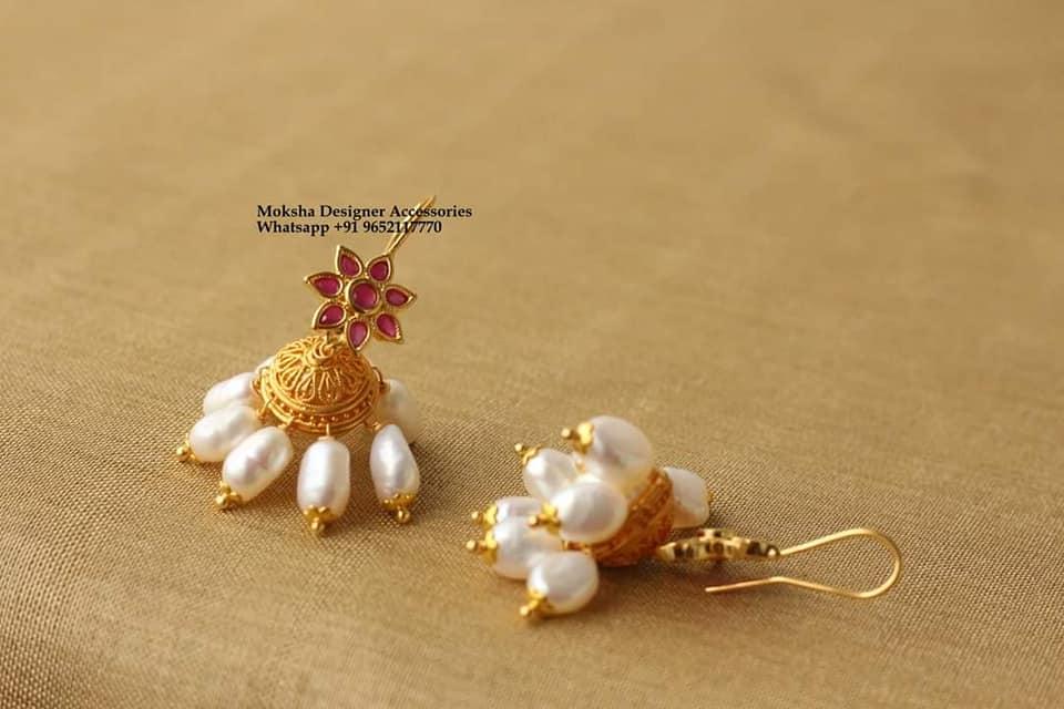 Beautiful one gram gold jumkhis with pearl hangings.