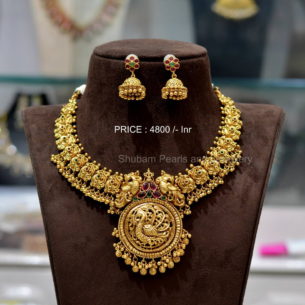 Stunning one gram gold nakshi work necklace with swan motifs and gunguru hangings.  Necklace with matching jumkhis. 1 gram gold jewellery with price 1 gm gold chain online one gram gold sets with price