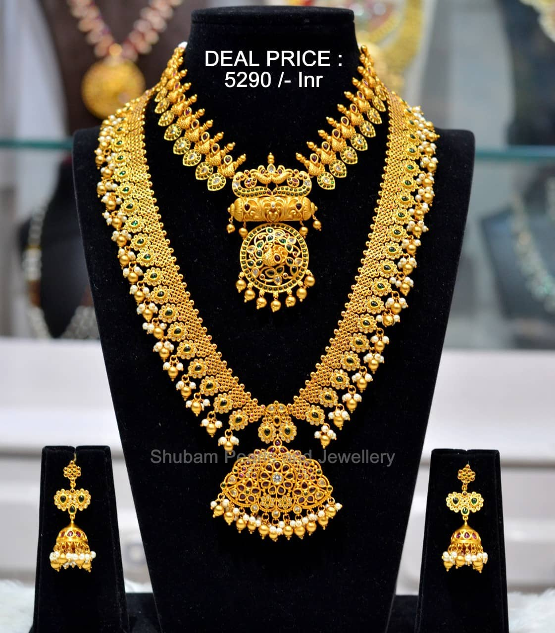 Beautiful one gram gold bridal set with necklace  and long haaram with matching jumkhis.