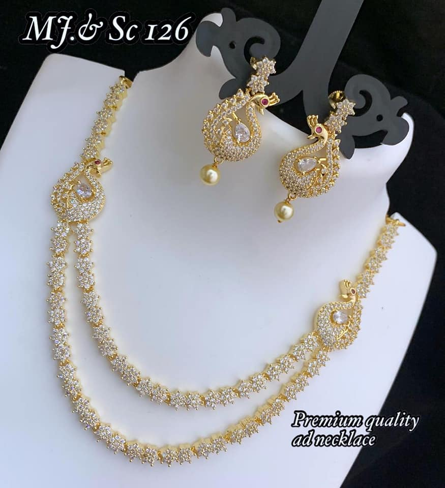 Beautiful one gram gold necklace studded with white CZs. Necklace with matching peacock earrings. 1 gram gold chains online 1 gm gold ornaments one gram temple jewellery