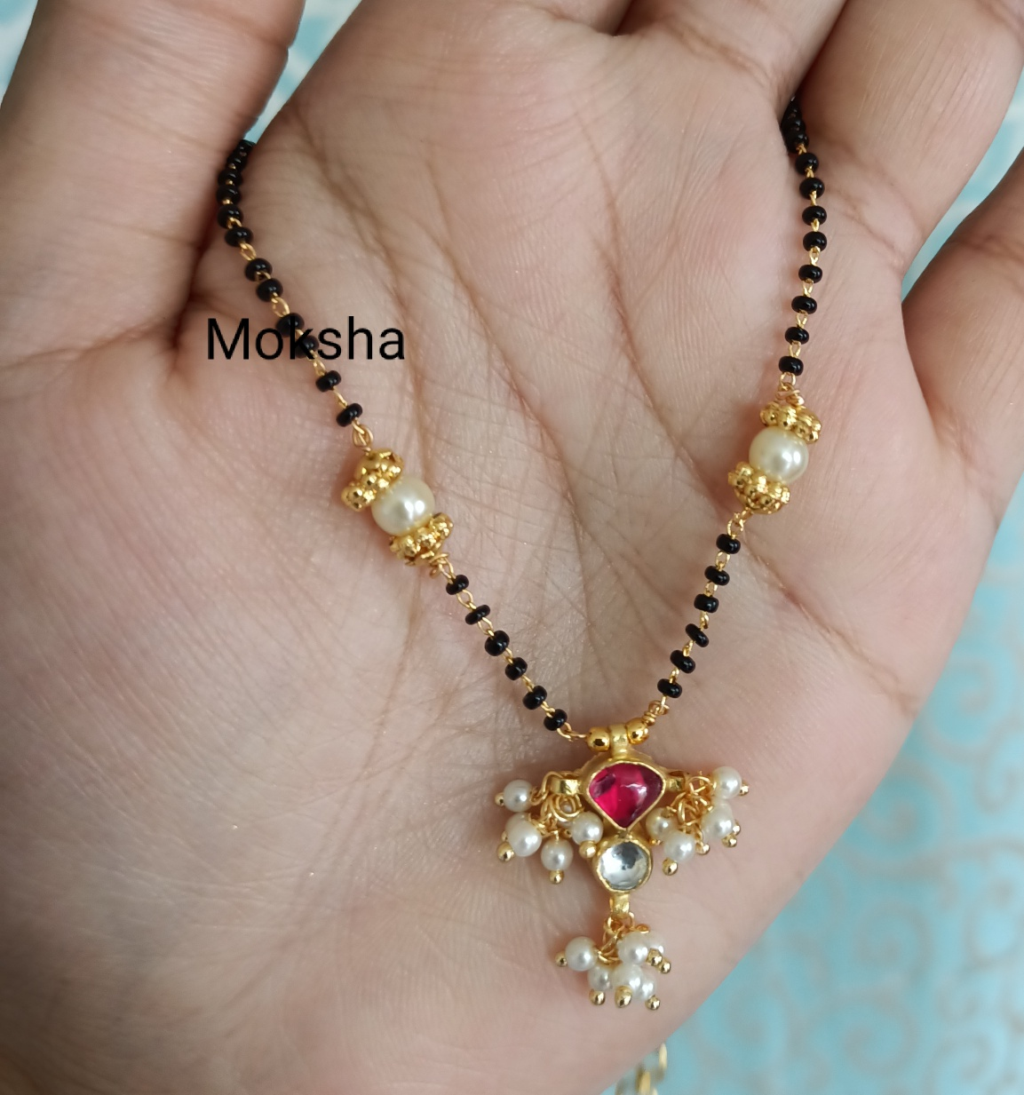 Beautiful one gram gold short black bead necklace. one gram gold antique jewellery one gram jewellery designs one gram jewellery designs
