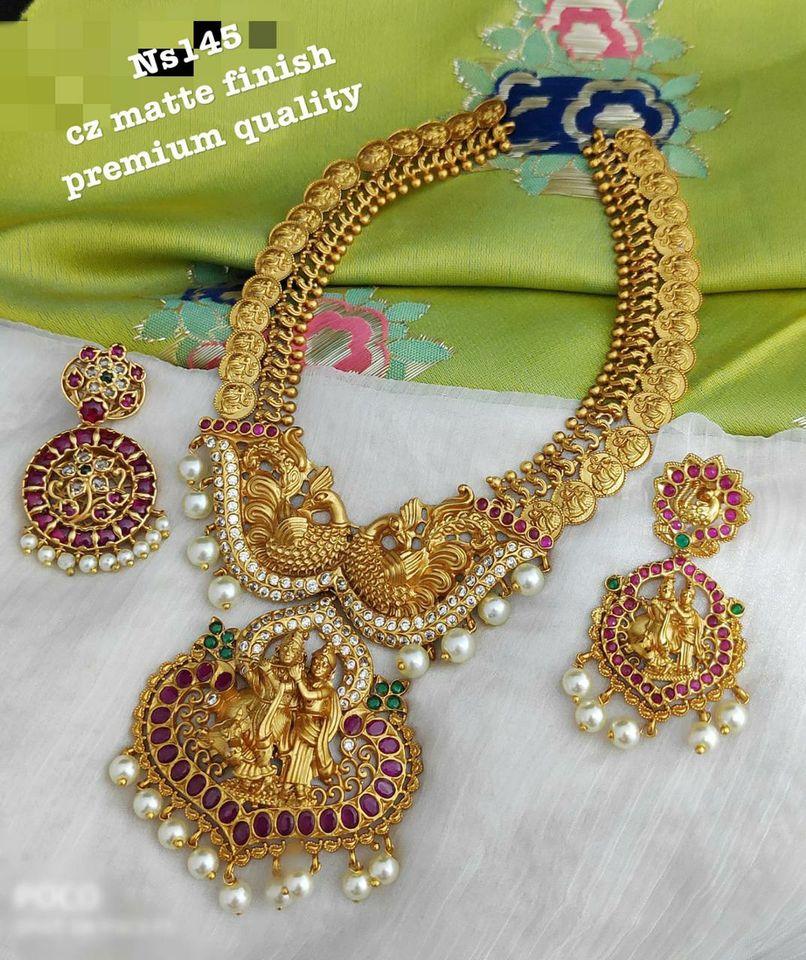Beautiful one gram gold Lakshmi kasu hangings long haaram with Radha Krishna pendant. 1 gram gold jewellery with price 1 gram gold shop one gram gold haram
