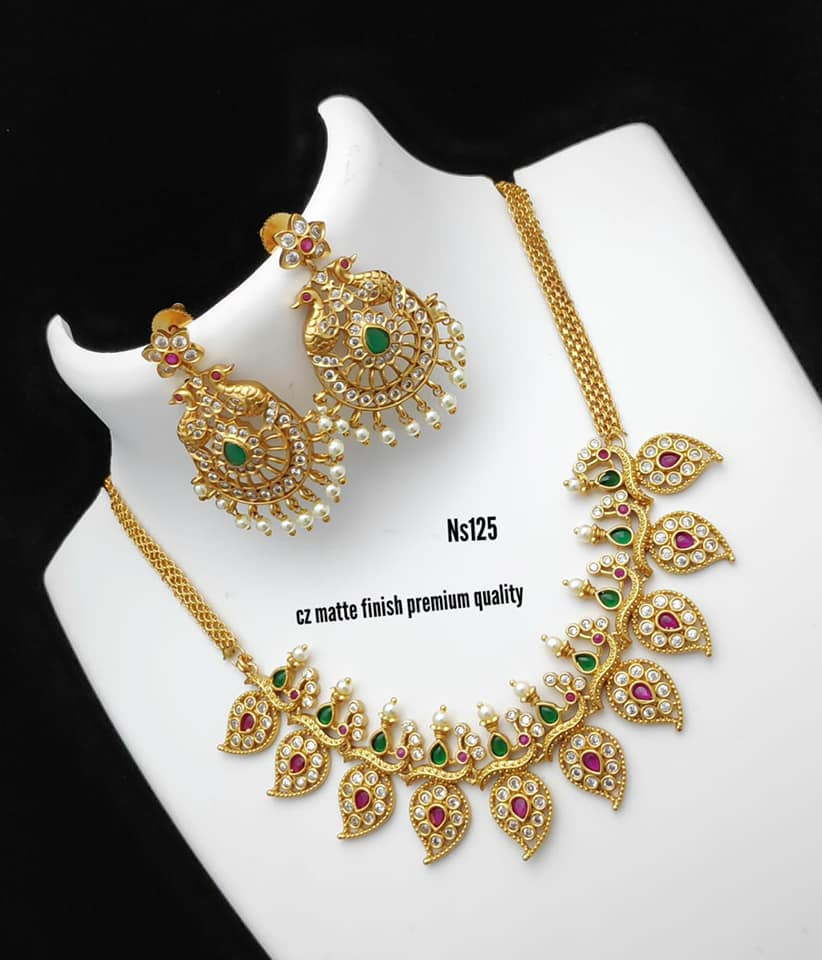 Beautiful one gram gold necklace with mango hangings. Necklace studded with multi color CZS. 1 gram necklace design 1gm jewellery designs parakkat one gram jewellery