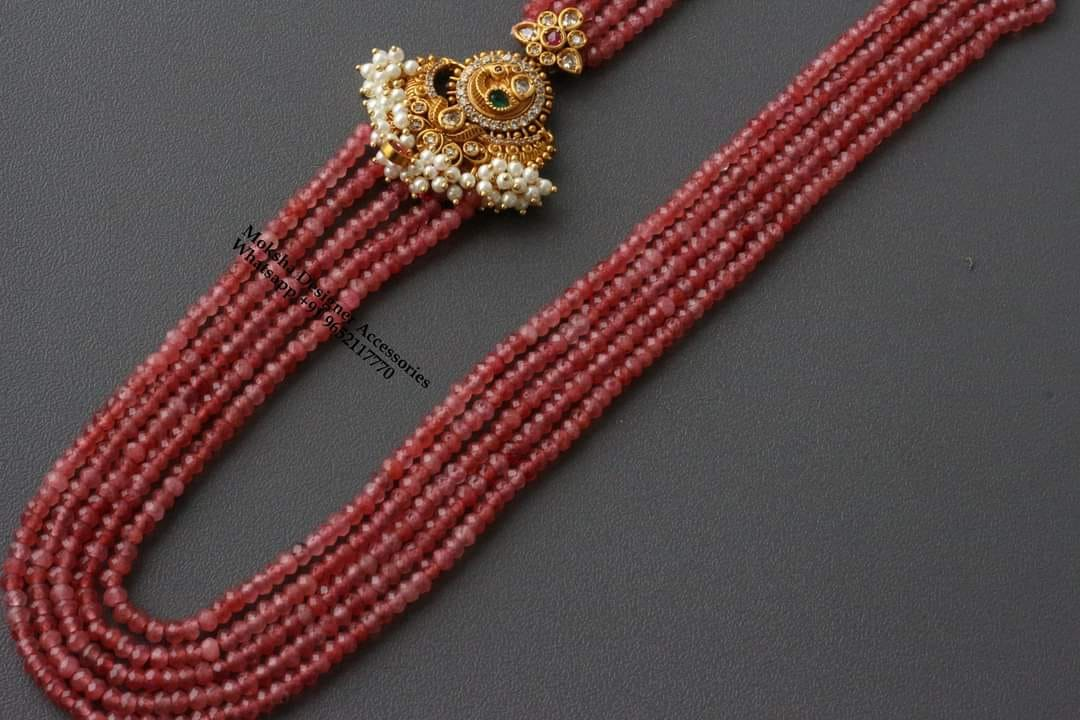 Beautiful one gram gold pink color bead long haaram with side guttapusalu side brooch. one gram gold jewellery sets online 1 gram gold designs with price one gram gold thali chain