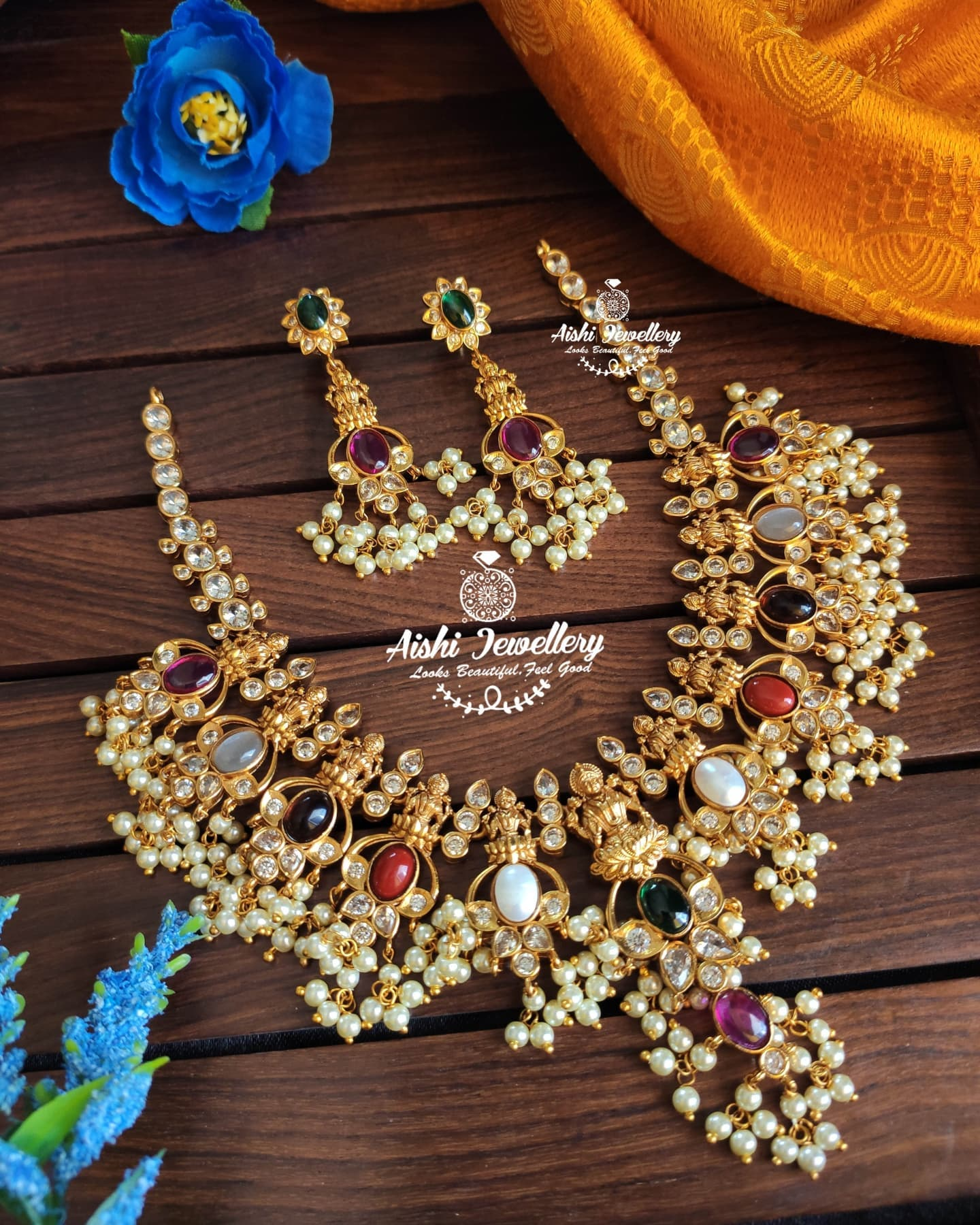 Gorgeous one gram gold tapusalu necklace studded with navaratan stones. 1 gm gold chain designs 1 gram gold sets online one gram gold chains online shopping