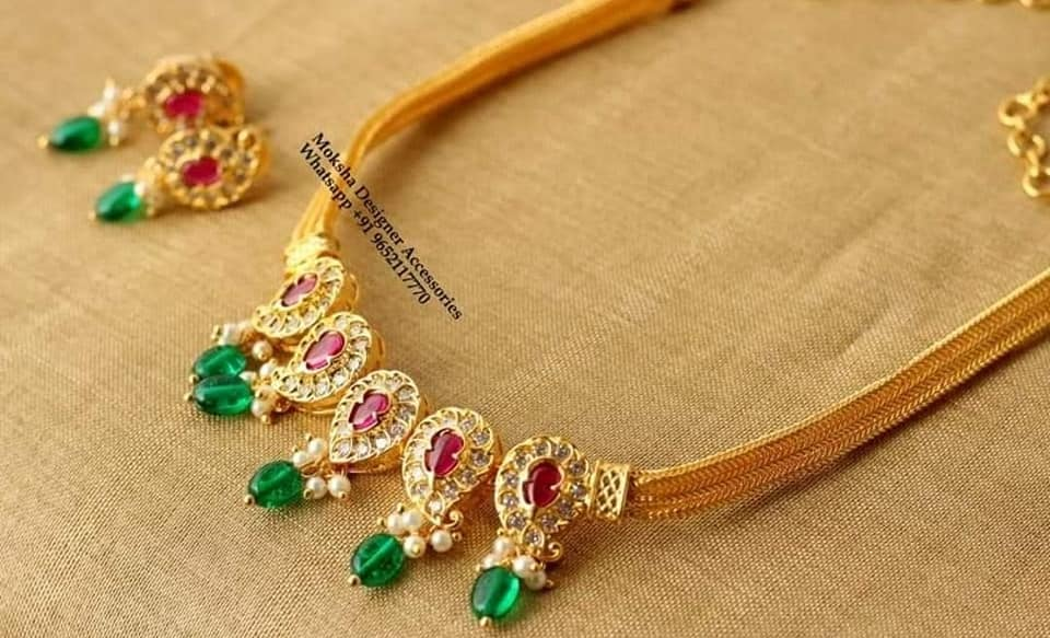 Beautiful one gram gold mango necklace studded with multi color stone. 1 gram gold chain for ladies 1 gram gold cz sets one gram jewellery designs