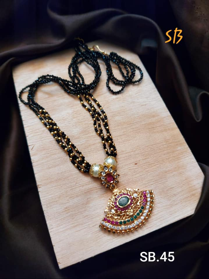 Beautiful one gram gold black bead chain studded with multi color stones.