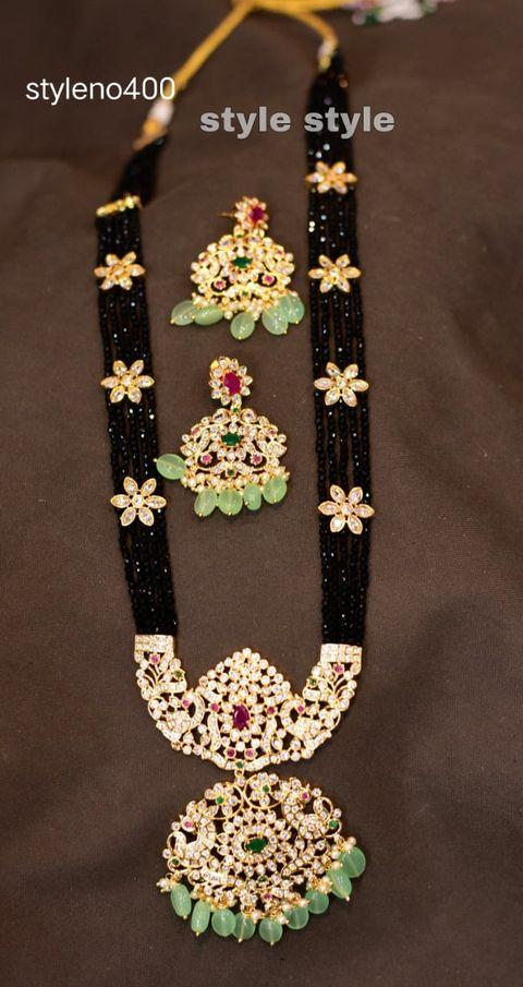 Beautiful one gram gold balck bead long haaram with  side brooch and matching earrings.  latest one gram gold jewellery lakshmi one gram jewellery guttapusalu haram 1 gram gold online