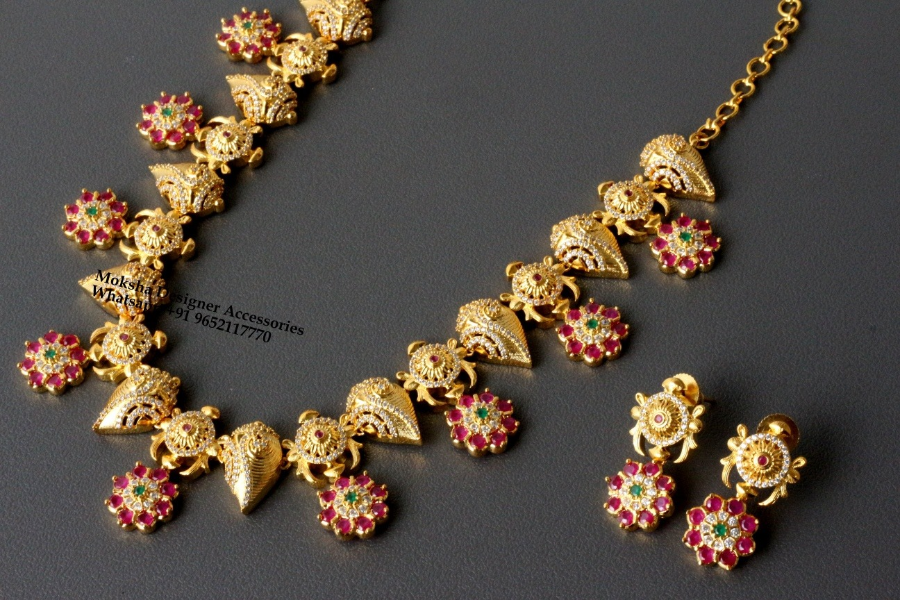 Beautiful one gram gold sanku chakra necklace with matching earrings. one gram gold necklace set online 1 gram gold antique jewellery latest 1 gram gold cz necklace sets with price