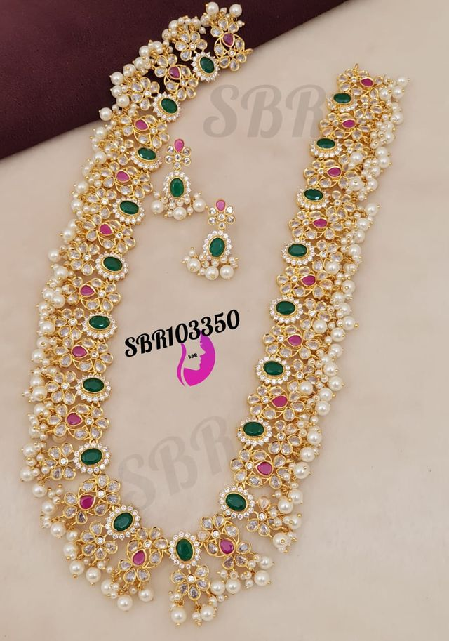 Beautiful one gram gold long haaram studded with multi precious stone. one gram gold plated chain 1 gram gold items one gram gold bridal sets