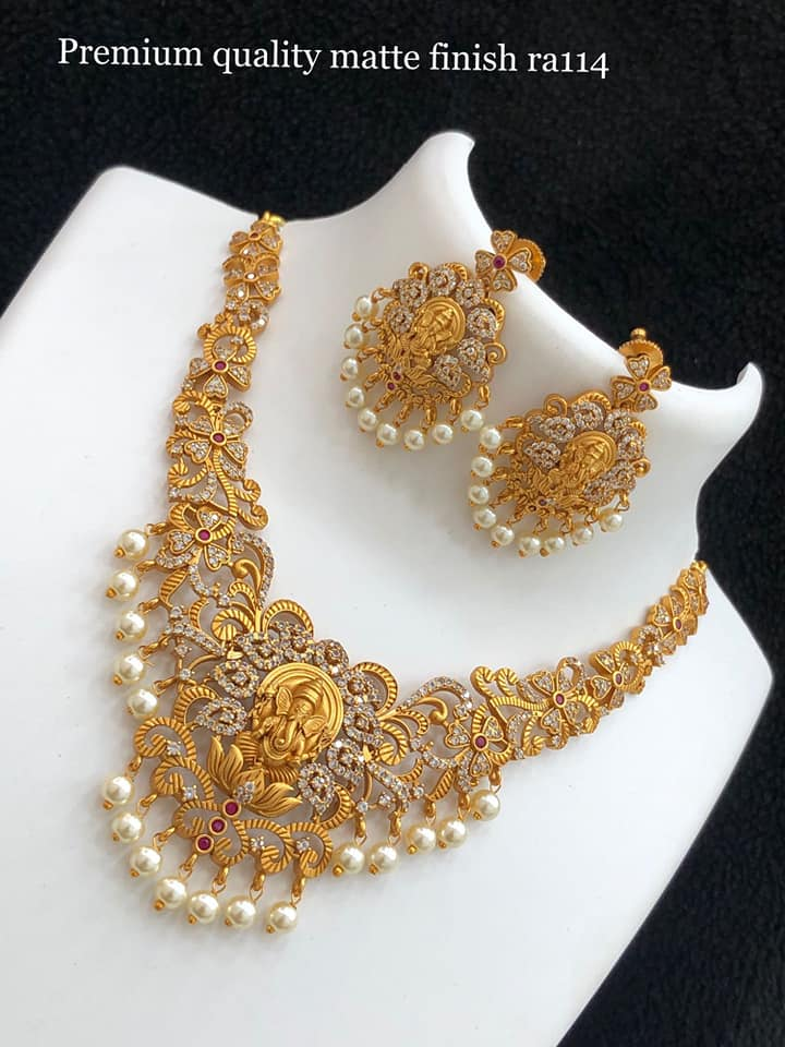 Beautiful one gram gold Lord Ganesha choker and matching earrings. 1 gram gold polish jewellery 1 gram gold designs with price one gram gold ornaments online
