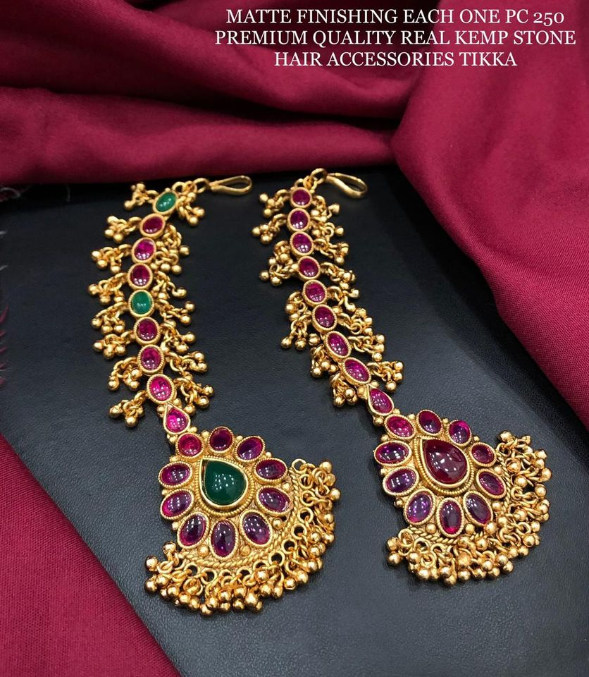 Beautiful one gram gold Maang tikka studded with multi color stones.