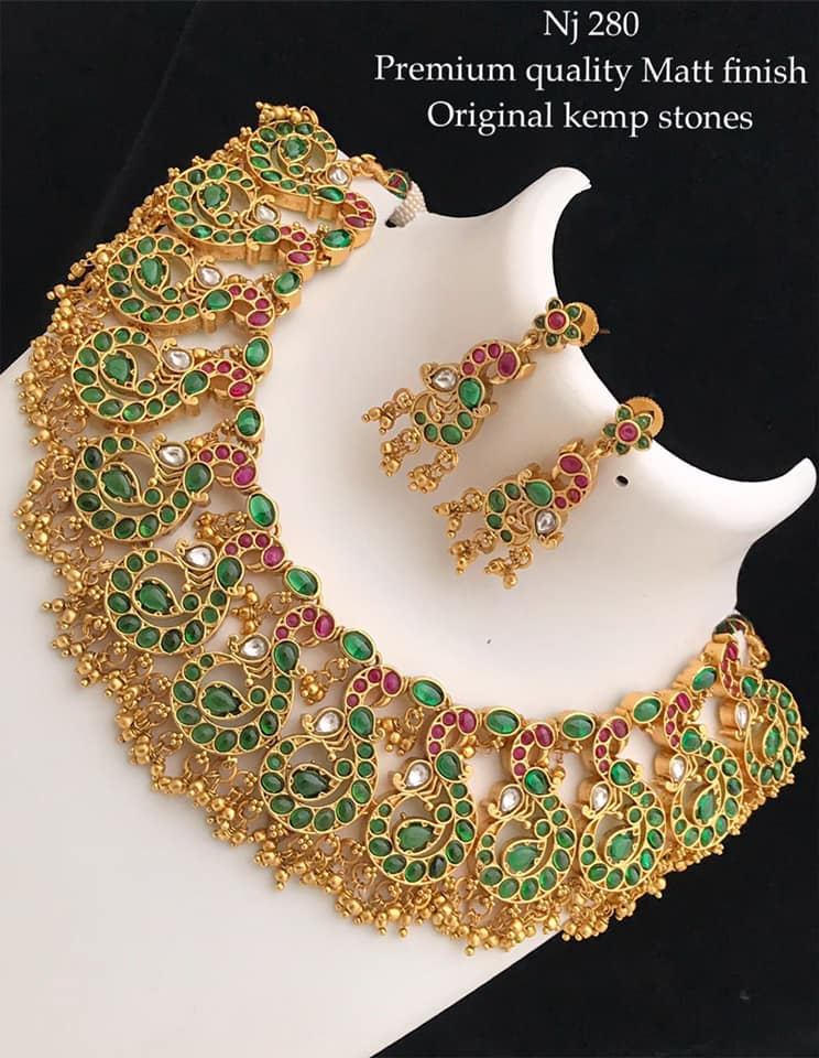 Beautiful one gram gold necklace studded with green and pink color kemp stones. Necklace with matching earrings. one gram gold chain designs one gram gold sets lali mix one gram gold