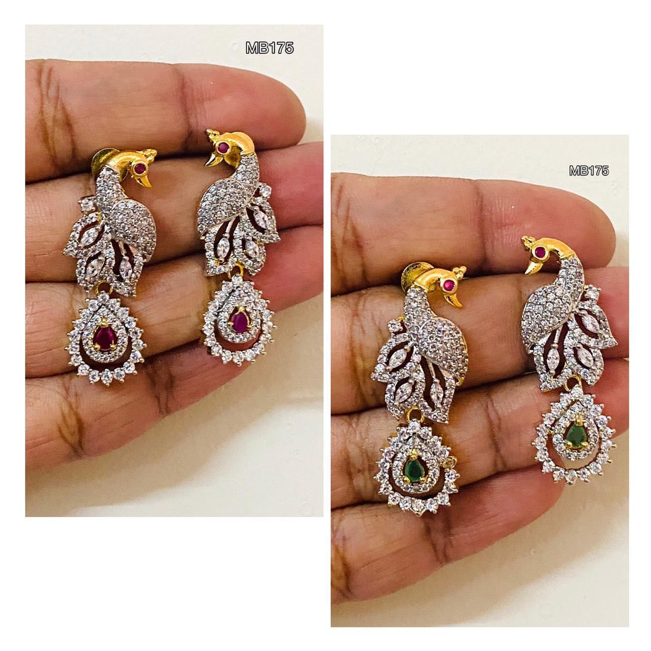 Beautiful one gram gold peacock earrings studded with multi color CZS. 1 gram gold bridal jewellery online one gram gold jhumkas with price one gram gold sets