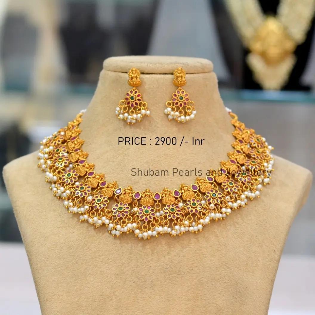 Beautiful one gram gold Lakshmi devi motif choker with guttapusalu hangings. Choker with matching earrings.