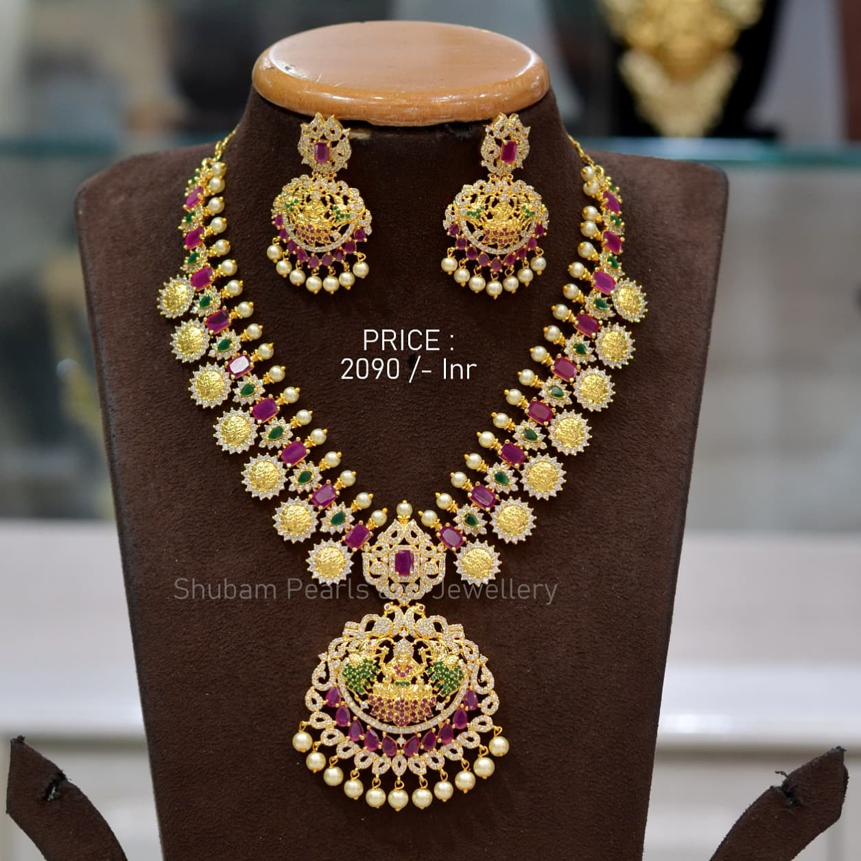Unique design of Goddess laxmi devi pendant with ramparivar kasul in golden polish with multi color stone and screwback earrings  For order Whatsapp 09030271018 begum bazar one gram gold shops guttapusalu haram 1 gram gold one gram gold long chains