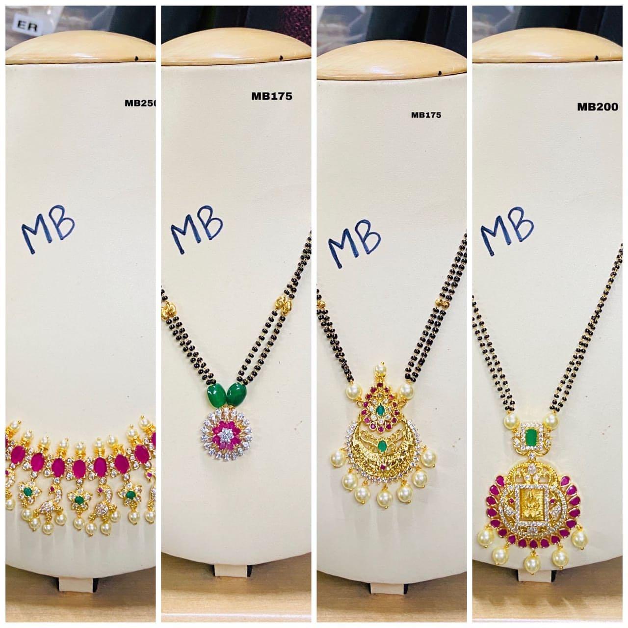 Beautiful one gram gold balck bead chain with cz studded pendant. 1 gram gold jewellery designs 1gm jewellery one gram gold thali chain