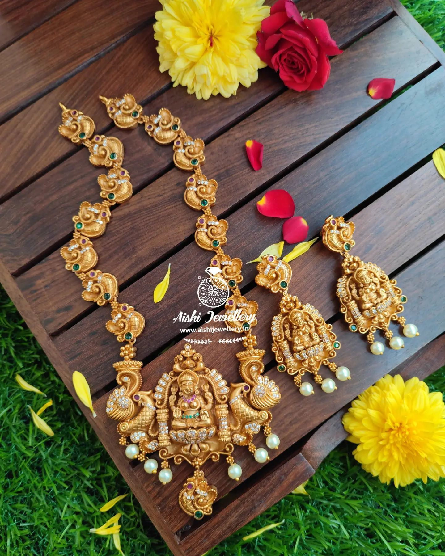 Beautiful one gram gold swan motifs long haaram with Lakshmi devi pendant and matching earrings. 1 gram jewellery set one gram gold jewellery with price 1 gram gold bridal jewellery sets with price