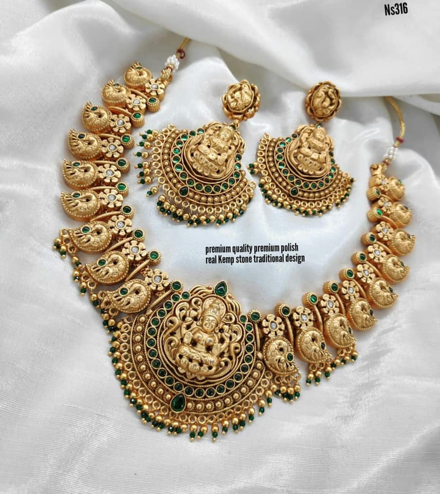 Beautiful one gram gold Lakshmi devi motif necklace with matching earrings. matte finish one gram gold jewellery 1 gram gold ruby necklace with price i gram gold jewellery